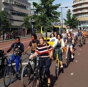 A typical scene in Utrecht, with an assortment of people cycling for transportation purposes, and not a single bit of helmet or high-vis garb in sight. Cycling is considered to be a normal activity.