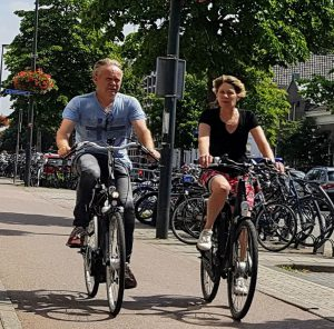 A couple cycle together in Utrecht.