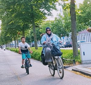A mother cycling with her son.