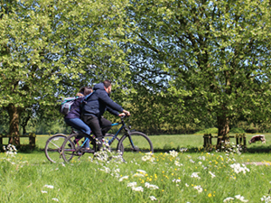 Two people cycling through Stourbridge Common
