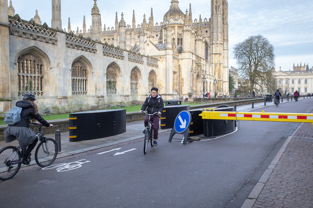 Cyclists negotiating the anti-terrorism barrier on King's Parade