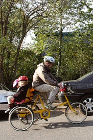 Children on a bike in traffic