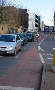 Cycle lane protecting cyclists from left-turning vehicles